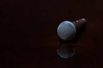 Vocal microphone on dark polished surface