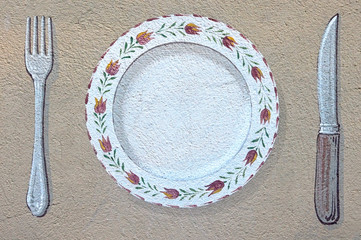 restaurant decoration - plate and cutlery painted on a wall.