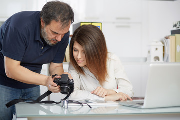 young female photographer learning by a master photographer