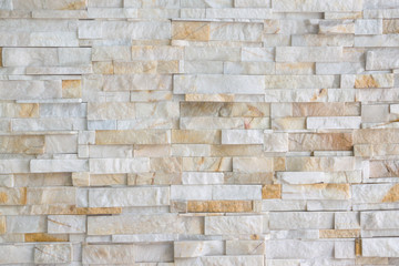 Pattern of grey and rough sandstone wall texture and background, stone Cladding wall