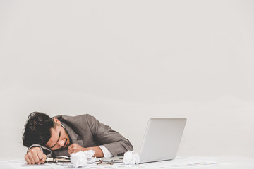 Tried overworked businessman sleeping on the office table