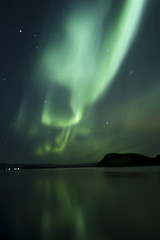 Aurora Borealis beautiful northern light in the clear night sky,  Iceland