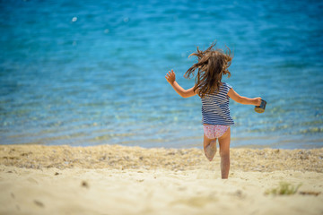 the girl running to the sea