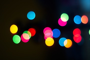 Blurred color bokeh of light from street abstract background.