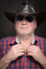 man in sunglasses and a hat
