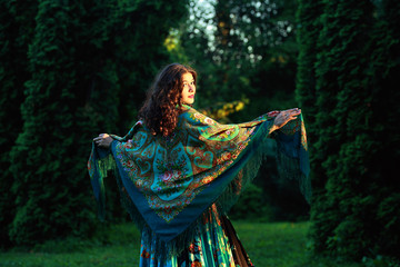 beautiful  Gypsy girl with a scarf in a forest