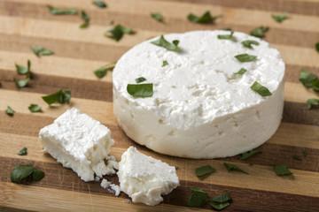 Feta cheese on wooden board