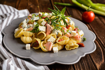 Pasta with salmon, sun dried tomato, Feta and Roquefort cheese