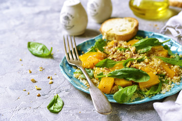 Pumpkin salad with quinoa,spinach and walnuts.