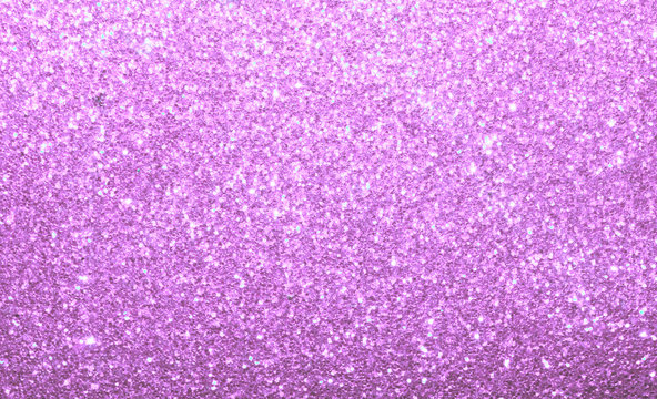 Light pink purple glitter sparkle background.  Abstract colorful twinkle backdrop.
