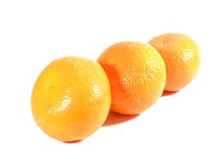 Three ripe oranges isolated on white background, close-up