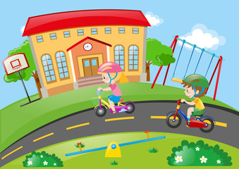 Boy and girl riding bike in the park