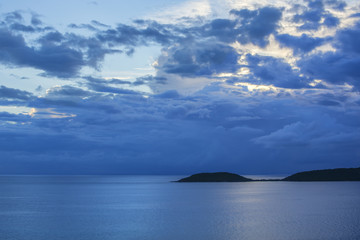 Moody sunset sky over tropical sea
