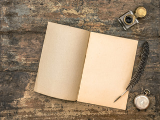 Open diary book and vintage office supplies