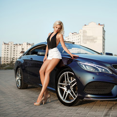 Sexy blonde woman with sport car luxury lifestyle