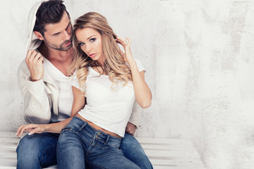 Fashionable couple in jeans.