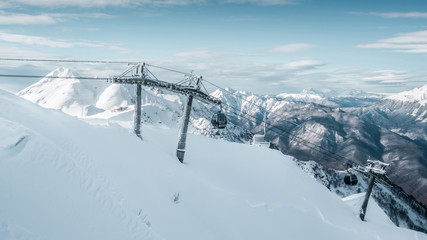 Fototapete - On the top of the Mountain. Winter landscape in mountains with cableway, panorama