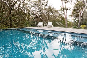 Stunning blue tiled infinity swimming pool in Australian bush se