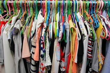 Colorful shirt on hanger, clothing on shelf