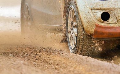 Rally car in muddy road