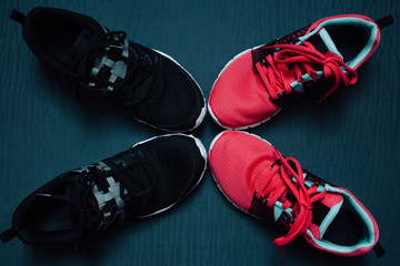 Woman's and man's running shoes