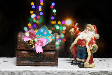 Fairy Santa Claus brought gifts for Christmas at the house with wooden treasure chest, decoration in night time with light boken, still life style
