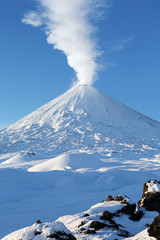 Poster Volcano Volcanic landscape of Kamchatka: winter view of eruption Klyuchevskoy Volcano - plume of gas, steam and ashes. Russia, Far East, Kamchatka Region, Klyuchevskaya Group of Volcanoes.