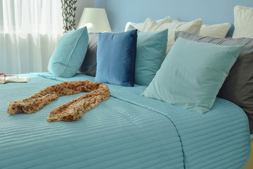 Scarf on bed in blue color scheme bedding