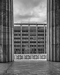 Athens Greece, a modern building facade view between two classical columns, black and white