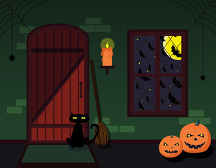 The interior of the witch house with broom, candle, pumpkins and