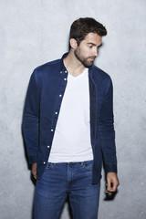 Man wearing blue fashion, looking away