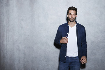 Cool dude in blue shirt and jeans, portrait