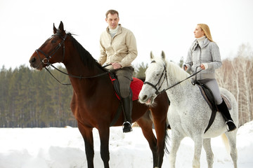 Portrait of wife and husband riding in open air