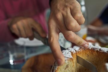 cutting the freshly baked cake