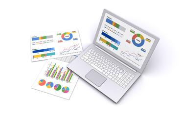 ノートパソコンとビジネス資料