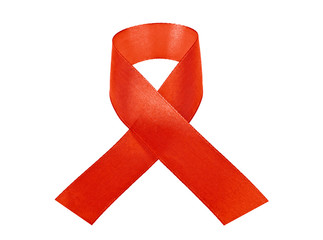 Red AIDS awareness ribbon isolated on white background