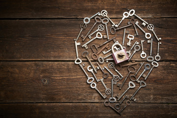 Valentine heart from different old keys with padlock, the concept of love
