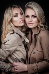 Two ladies in overcoats
