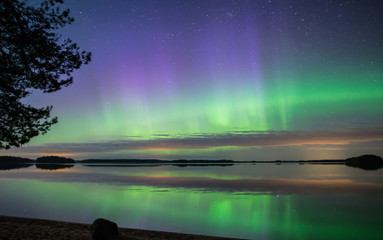 Scenic view of northern lights over calm lake