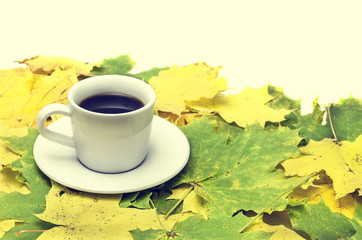 autumn leaves and a cup of coffee