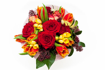 Floral bouquet of roses, tulips and freesia isolated on white background