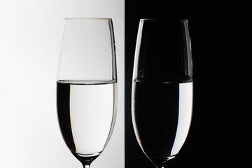 two glasses on the black and white