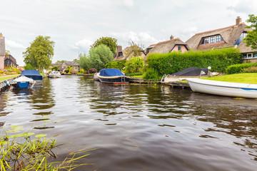 Small river in front of Dutch villa's