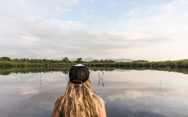Rear view of young woman looking out over lake, Gili Meno, Lombok, Indonesia