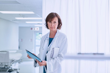 Portrait of confident female doctor in hospital ward