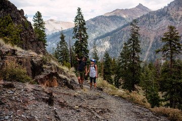 Mid adult couple hiking along pathway, Mineral King, Sequoia National Park, California, USA