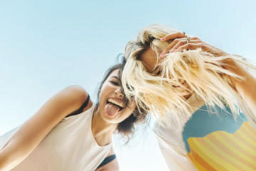 Low angle view of young women smiling at camera