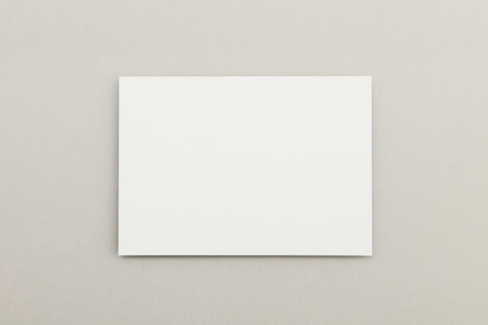 Blank white poster flyer on a grey background