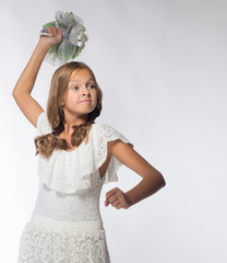 emotional cheerful blonde girl in a white dress with a bouquet of flowers on a white background