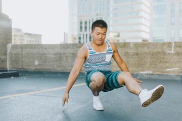Man breakdancing on concrete floor, Boston, Massachusetts, USA